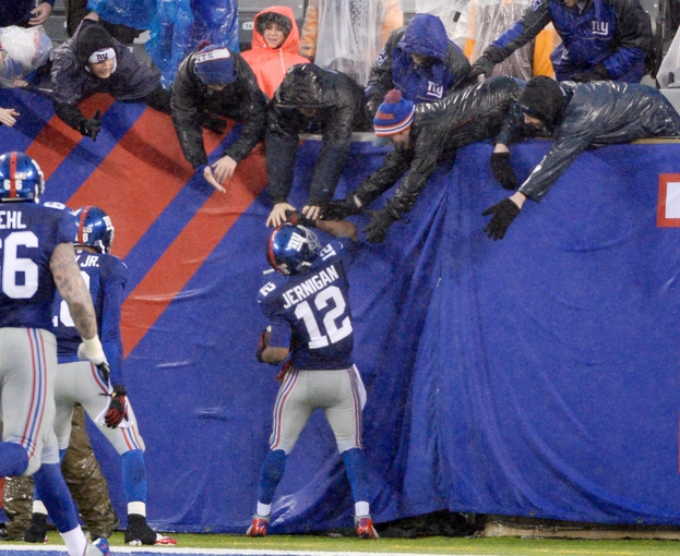 Dec 29, 2013; East Rutherford, NJ, USA; New York Giants wide receiver Jerrel Jernigan (12) celebrates with fans after a touchdown in the third quarter against the Washington Redskins during the game at MetLife Stadium. Mandatory Credit: Robert Deutsch-USA TODAY Sports