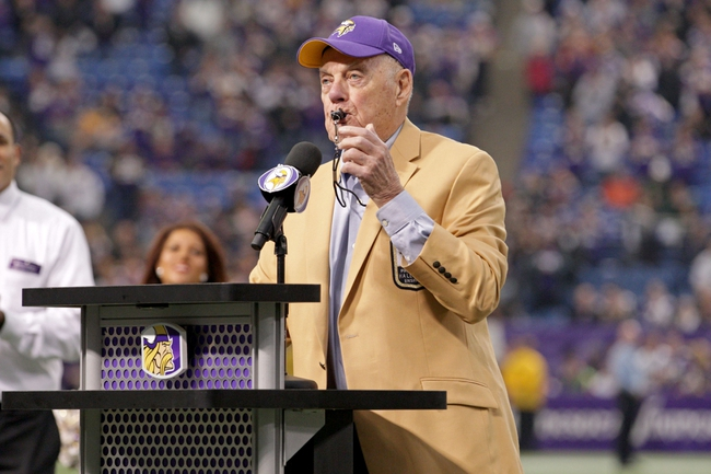 Dec 29, 2013; Minneapolis, MN, USA; Former Minnesota Vikings head coach Bud Grant blows a whistle during the closing ceremony following the game against the Detroit Lions at Mall of America Field at H.H.H. Metrodome. The Vikings defeated the Lions 14-13. Mandatory Credit: Brace Hemmelgarn-USA TODAY Sports