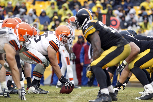 Dec 29, 2013; Pittsburgh, PA, USA; Cleveland Browns center Alex Mack (55) prepares to snap the ball against the Pittsburgh Steelers defense during the fourth quarter at Heinz Field. The Pittsburgh Steelers won 20-7. Mandatory Credit: Charles LeClaire-USA TODAY Sports