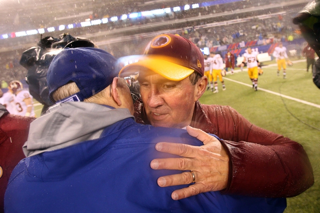 Dec 29, 2013; East Rutherford, NJ, USA; New York Giants head coach Tom Coughlin hugs Washington Redskins head coach Mike Shanahan after a game at MetLife Stadium. The Giants defeated the Redskins 20-6. Mandatory Credit: Brad Penner-USA TODAY Sports