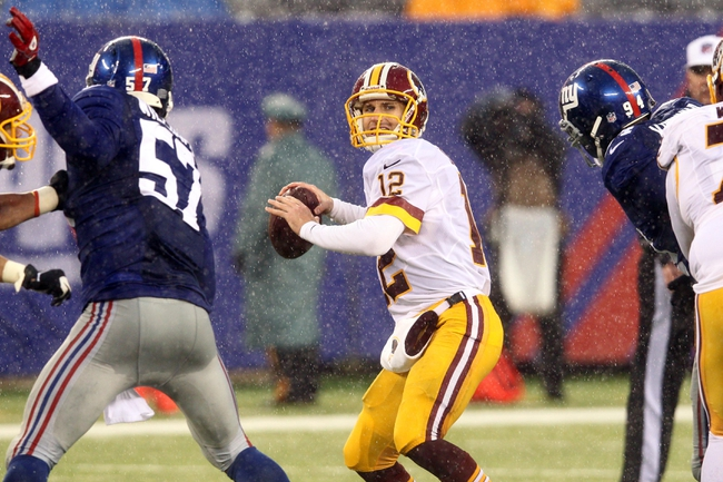 Dec 29, 2013; East Rutherford, NJ, USA; Washington Redskins quarterback Kirk Cousins (12) drops back to pass against the New York Giants during the fourth quarter of a game at MetLife Stadium. The Giants defeated the Redskins 20-6. Mandatory Credit: Brad Penner-USA TODAY Sports