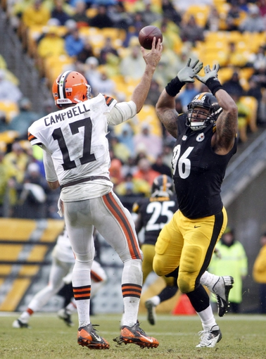 Dec 29, 2013; Pittsburgh, PA, USA; Cleveland Browns quarterback Jason Campbell (17) passes the ball under pressure from Pittsburgh Steelers defensive end Ziggy Hood (96) during the fourth quarter at Heinz Field. The Pittsburgh Steelers won 20-7. Mandatory Credit: Charles LeClaire-USA TODAY Sports