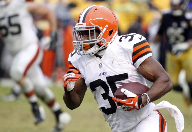 Dec 29, 2013; Pittsburgh, PA, USA; Cleveland Browns running back Fozzy Whittaker (35) runs with the ball on a thirty five yard pass reception for a touchdown against the Pittsburgh Steelers during the fourth quarter at Heinz Field. The Pittsburgh Steelers won 20-7. Mandatory Credit: Charles LeClaire-USA TODAY Sports
