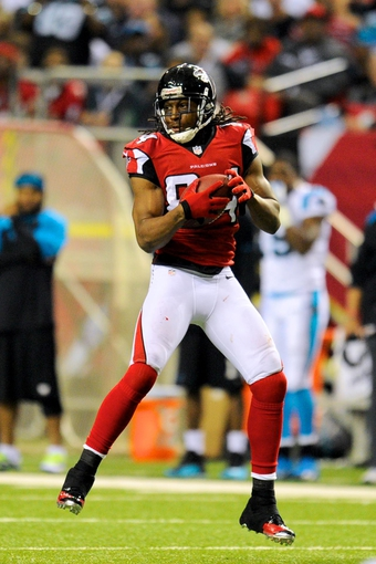 Dec 29, 2013; Atlanta, GA, USA; Atlanta Falcons wide receiver Roddy White (84) catches a pass against the Carolina Panthers during the second half at the Georgia Dome. The Panthers defeated the Falcons 21-20. Mandatory Credit: Dale Zanine-USA TODAY Sports