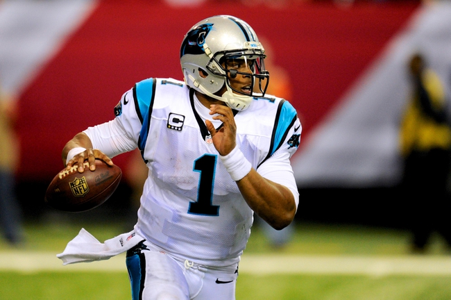 Dec 29, 2013; Atlanta, GA, USA; Carolina Panthers quarterback Cam Newton (1) runs with the ball against the Atlanta Falcons during the second half at the Georgia Dome. The Panthers defeated the Falcons 21-20. Mandatory Credit: Dale Zanine-USA TODAY Sports