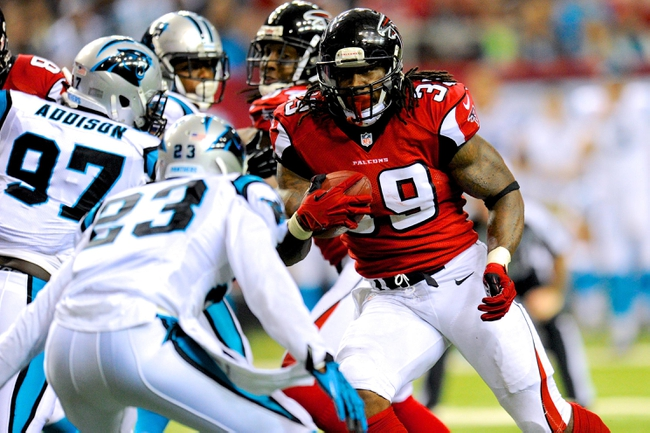 Dec 29, 2013; Atlanta, GA, USA; Atlanta Falcons running back Steven Jackson (39) runs against the defense of Carolina Panthers cornerback Melvin White (23) during the second half at the Georgia Dome. The Panthers defeated the Falcons 21-20. Mandatory Credit: Dale Zanine-USA TODAY Sports