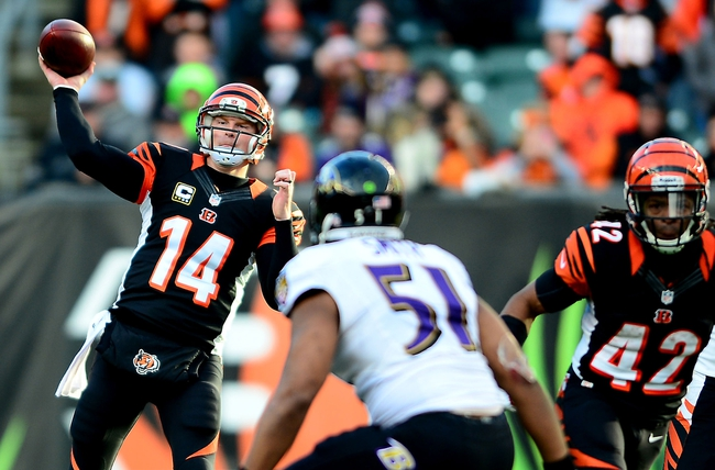 Dec 29, 2013; Cincinnati, OH, USA; Cincinnati Bengals quarterback Andy Dalton (14) throws the ball during the fourth quarter against the Baltimore Ravens at Paul Brown Stadium. The Bengals won 34-17. Mandatory Credit: Andrew Weber-USA TODAY Sports