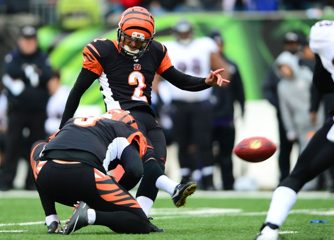 Dec 29, 2013; Cincinnati, OH, USA; Cincinnati Bengals kicker Mike Nugent (2) kicks a field goal during the fourth quarter against the Baltimore Ravens at Paul Brown Stadium. The Bengals won 34-17. Mandatory Credit: Andrew Weber-USA TODAY Sports