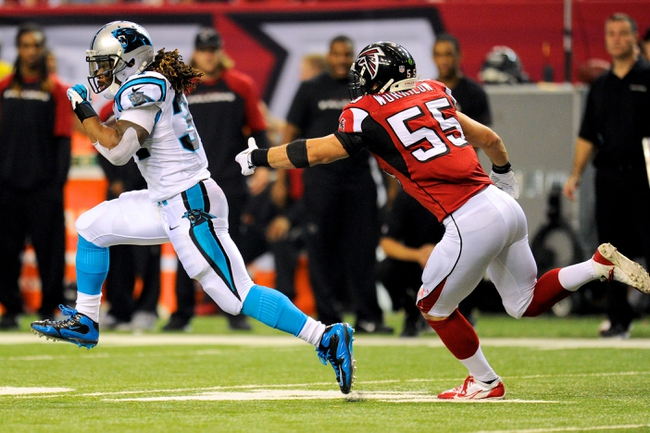 Dec 29, 2013; Atlanta, GA, USA; Carolina Panthers running back DeAngelo Williams (34) runs past Atlanta Falcons linebacker Paul Worrilow (55) during the first half at the Georgia Dome. The Panthers defeated the Falcons 21-20. Mandatory Credit: Dale Zanine-USA TODAY Sports