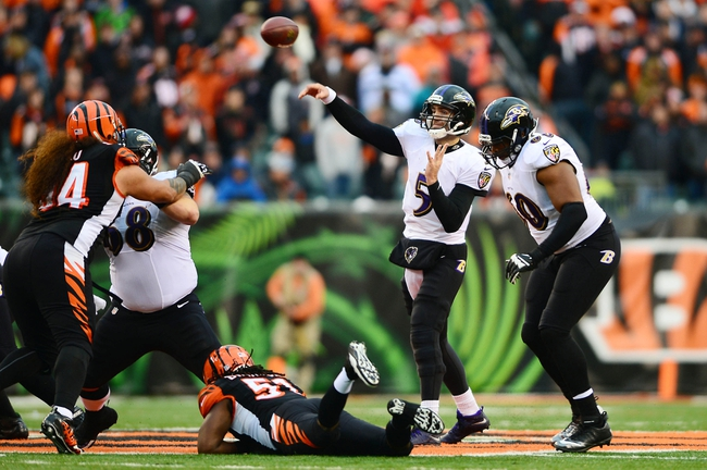 Dec 29, 2013; Cincinnati, OH, USA; Baltimore Ravens quarterback Joe Flacco (5) throws a pass during the fourth quarter against the Cincinnati Bengals at Paul Brown Stadium. Bengals defeated the Ravens 34-17. Mandatory Credit: Andrew Weber-USA TODAY Sports