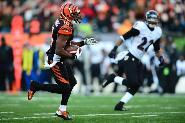 Dec 29, 2013; Cincinnati, OH, USA; Cincinnati Bengals wide receiver Andrew Hawkins (16) runs with the ball during the fourth quarter against the Baltimore Ravens at Paul Brown Stadium. The Bengals won 34-17. Mandatory Credit: Andrew Weber-USA TODAY Sports