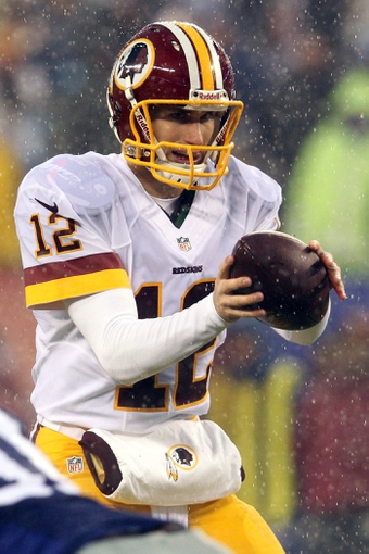 Dec 29, 2013; East Rutherford, NJ, USA; Washington Redskins quarterback Kirk Cousins (12) drops back to pass against the New York Giants during the third quarter of a game at MetLife Stadium. The Giants defeated the Redskins 20-6. Mandatory Credit: Brad Penner-USA TODAY Sports