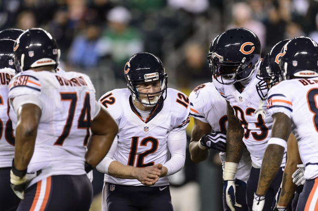 Dec 22, 2013; Philadelphia, PA, USA; Chicago Bears quarterback Josh McCown (12) breaks the huddle during the fourth quarter against the Philadelphia Eagles at Lincoln Financial Field. The Eagles defeated the Bears 54-11. Mandatory Credit: Howard Smith-USA TODAY Sports