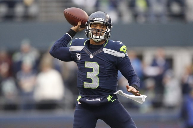 Dec 29, 2013; Seattle, WA, USA; Seattle Seahawks quarterback Russell Wilson (3) throws the ball against the St. Louis Rams during the third quarter at CenturyLink Field. Mandatory Credit: Joe Nicholson-USA TODAY Sports