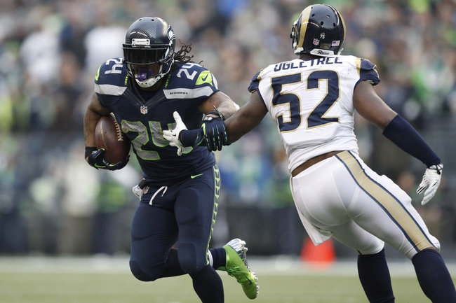 Dec 29, 2013; Seattle, WA, USA; Seattle Seahawks running back Marshawn Lynch (24) carries the ball against the St. Louis Rams during the third quarter at CenturyLink Field. Mandatory Credit: Joe Nicholson-USA TODAY Sports