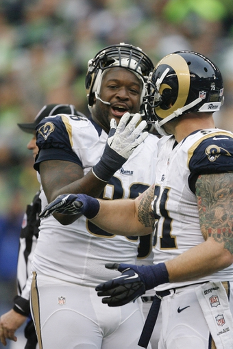Dec 29, 2013; Seattle, WA, USA; St. Louis Rams defensive tackle Kendall Langford (98) reacts to being ejected against the St. Louis Rams during the third quarter at CenturyLink Field. Mandatory Credit: Joe Nicholson-USA TODAY Sports