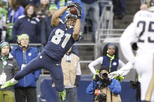 Dec 29, 2013; Seattle, WA, USA; Seattle Seahawks wide receiver Golden Tate (81) catches the ball to score a touchdown against the St. Louis Rams during the fourth quarter at CenturyLink Field. Mandatory Credit: Joe Nicholson-USA TODAY Sports