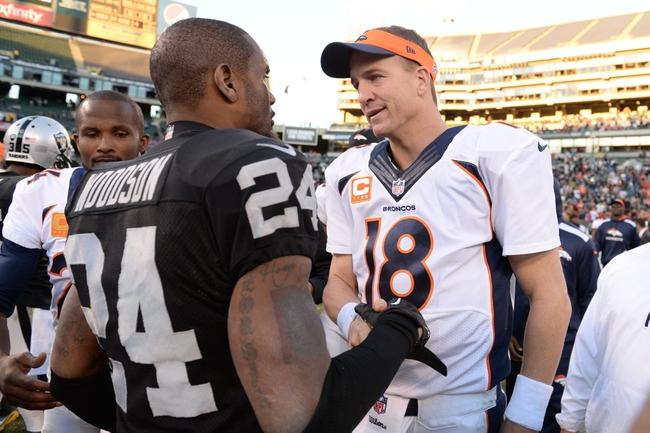 December 29, 2013; Oakland, CA, USA; Denver Broncos quarterback Peyton Manning (18) shakes hands with Oakland Raiders free safety Charles Woodson (24) after the game at O.co Coliseum. The Broncos defeated the Raiders 34-14. Mandatory Credit: Kyle Terada-USA TODAY Sports