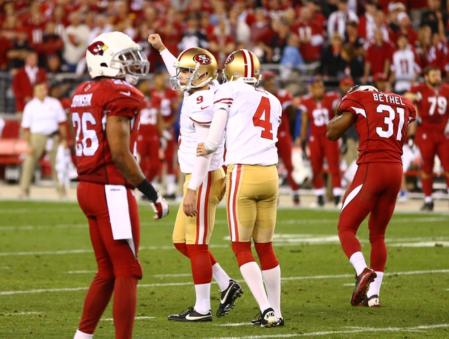 Dec 29, 2013; Phoenix, AZ, USA; San Francisco 49ers kicker Phil Dawson (9) celebrates after kicking the game winning field goal against the Arizona Cardinals at University of Phoenix Stadium. The 49ers defeated the Cardinals 23-20. Mandatory Credit: Mark J. Rebilas-USA TODAY Sports