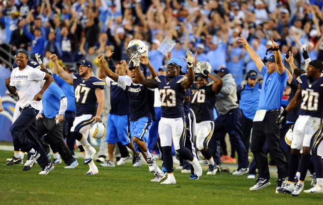 Dec 29, 2013; San Diego, CA, USA; San Diego Chargers players celebrate after a win against the Kansas City Chiefs at Qualcomm Stadium. The Chargers won 27-24 in overtime. Mandatory Credit: Christopher Hanewinckel-USA TODAY Sports