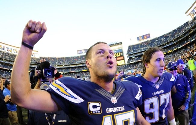 Dec 29, 2013; San Diego, CA, USA; San Diego Chargers quarterback Philip Rivers (17) celebrates after a win against the Kansas City Chiefs at Qualcomm Stadium. The Chargers won 27-24 in overtime. Mandatory Credit: Christopher Hanewinckel-USA TODAY Sports