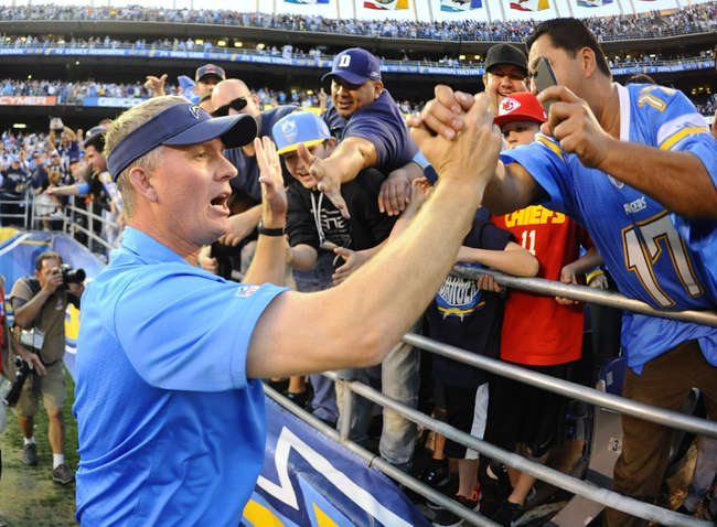 Dec 29, 2013; San Diego, CA, USA; San Diego Chargers head coach Mike McCoy celebrates with fans after a win against the Kansas City Chiefs at Qualcomm Stadium. The Chargers won 27-24 in overtime. Mandatory Credit: Christopher Hanewinckel-USA TODAY Sports