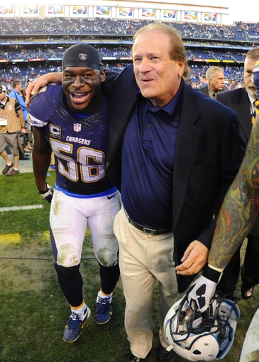 Dec 29, 2013; San Diego, CA, USA; San Diego Chargers linebacker Donald Butler (56) celebrates with Chargers president Dean Spanos after a win against the Kansas City Chiefs at Qualcomm Stadium. The Chargers won 27-24 in overtime. Mandatory Credit: Christopher Hanewinckel-USA TODAY Sports
