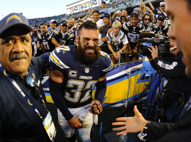 Dec 29, 2013; San Diego, CA, USA; San Diego Chargers safety Eric Weddle (32) reacts after a win against the Kansas City Chiefs at Qualcomm Stadium. The Chargers won 27-24 in overtime. Mandatory Credit: Christopher Hanewinckel-USA TODAY Sports