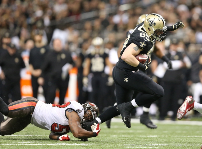 Dec 29, 2013; New Orleans, LA, USA; New Orleans Saints tight end Josh Hill (89) is tripped up by Tampa Bay Buccaneers outside linebacker Adam Hayward (57) in the second half at the Mercedes-Benz Superdome. New Orleans defeated Tampa Bay 42-17. Mandatory Credit: Crystal LoGiudice-USA TODAY Sports