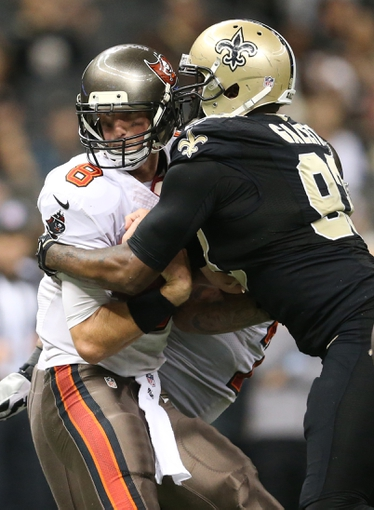 Dec 29, 2013; New Orleans, LA, USA; Tampa Bay Buccaneers quarterback Mike Glennon (8) is sacked by New Orleans Saints outside linebacker Junior Galette (93) in the second half at the Mercedes-Benz Superdome. New Orleans defeated Tampa Bay 42-17. Mandatory Credit: Crystal LoGiudice-USA TODAY Sports