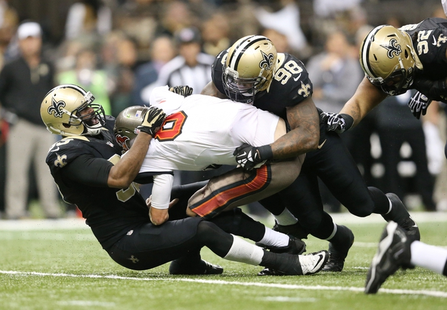 Dec 29, 2013; New Orleans, LA, USA; Tampa Bay Buccaneers quarterback Mike Glennon (8) is sacked by New Orleans Saints outside linebacker Junior Galette (left) and outside linebacker Parys Haralson (98) in the second half at the Mercedes-Benz Superdome. New Orleans defeated Tampa Bay 42-17. Mandatory Credit: Crystal LoGiudice-USA TODAY Sports