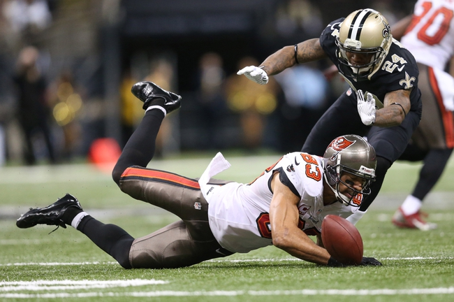 Dec 29, 2013; New Orleans, LA, USA; Tampa Bay Buccaneers wide receiver Vincent Jackson (83) drops a pass in front of New Orleans Saints cornerback Corey White (24) in the second half at the Mercedes-Benz Superdome. New Orleans defeated Tampa Bay 42-17. Mandatory Credit: Crystal LoGiudice-USA TODAY Sports