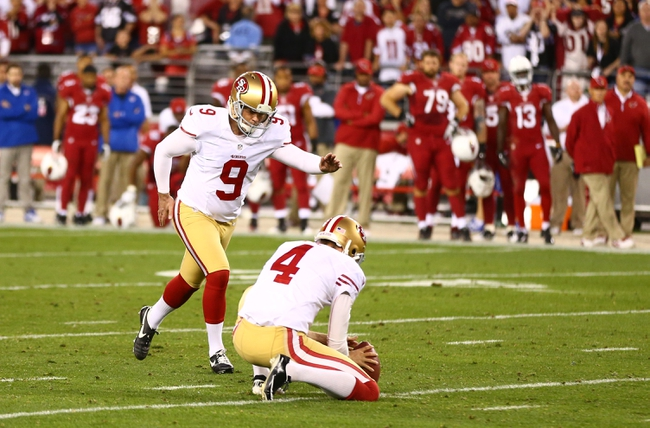 Dec 29, 2013; Phoenix, AZ, USA; San Francisco 49ers kicker Phil Dawson (9) kicks the game winning field goal against the Arizona Cardinals at University of Phoenix Stadium. The 49ers defeated the Cardinals 23-20. Mandatory Credit: Mark J. Rebilas-USA TODAY Sports