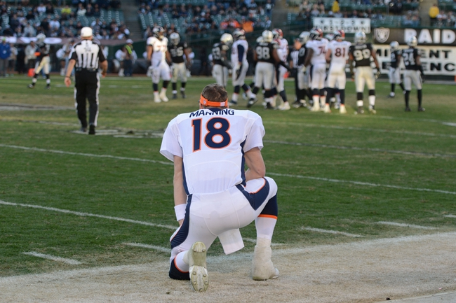December 29, 2013; Oakland, CA, USA; Denver Broncos quarterback Peyton Manning (18) looks on from the sideline during the fourth quarter against the Oakland Raiders at O.co Coliseum. The Broncos defeated the Raiders 34-14. Mandatory Credit: Kyle Terada-USA TODAY Sports