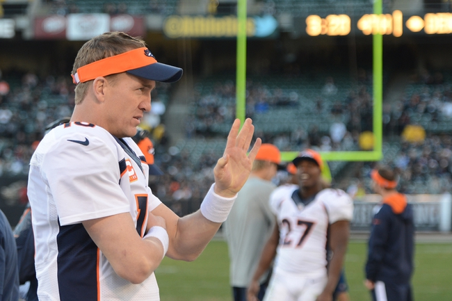 December 29, 2013; Oakland, CA, USA; Denver Broncos quarterback Peyton Manning (18) waves to the crowd during the fourth quarter against the Oakland Raiders at O.co Coliseum. The Broncos defeated the Raiders 34-14. Mandatory Credit: Kyle Terada-USA TODAY Sports