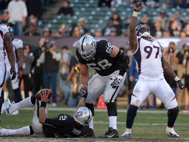 Dec 29, 2013; Oakland, CA, USA; Denver Broncos defensive end Malik Jackson (97) celebrates after sacking Oakland Raiders quarterback Terrelle Pryor (2) in the fourth quarter at O.co Coliseum. The Broncos won 34-14. Mandatory Credit: Kirby Lee-USA TODAY Sports