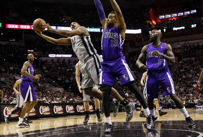 Dec 29, 2013; San Antonio, TX, USA; San Antonio Spurs forward Boris Diaw (left) drives to the basket as Sacramento Kings forward Derrick Williams (13) defends during the first half at the AT&T Center. Mandatory Credit: Soobum Im-USA TODAY Sports