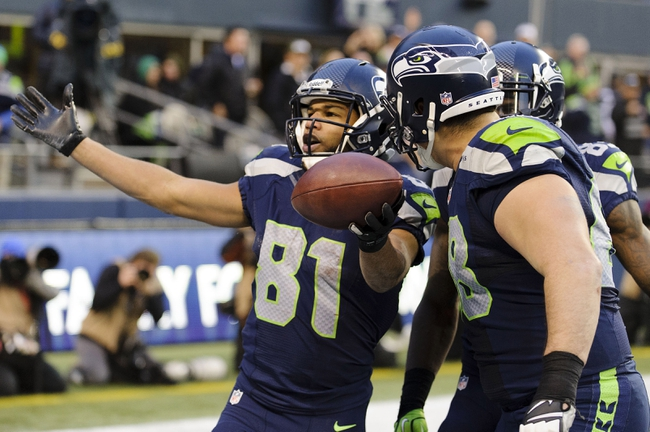 Dec 29, 2013; Seattle, WA, USA; Seattle Seahawks wide receiver Golden Tate (81) celebrates with the fans after scoring a touchdown against the St. Louis Rams during the fourth quarter at CenturyLink Field. Seattle defeated St. Louis 27-9. Mandatory Credit: Steven Bisig-USA TODAY Sports