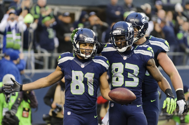 Dec 29, 2013; Seattle, WA, USA; Seattle Seahawks wide receiver Golden Tate (81) celebrates after scoring a touchdown with Seattle Seahawks wide receiver Ricardo Lockette (83) during the fourth quarter at CenturyLink Field. Seattle won 27-9. Mandatory Credit: Steven Bisig-USA TODAY Sports