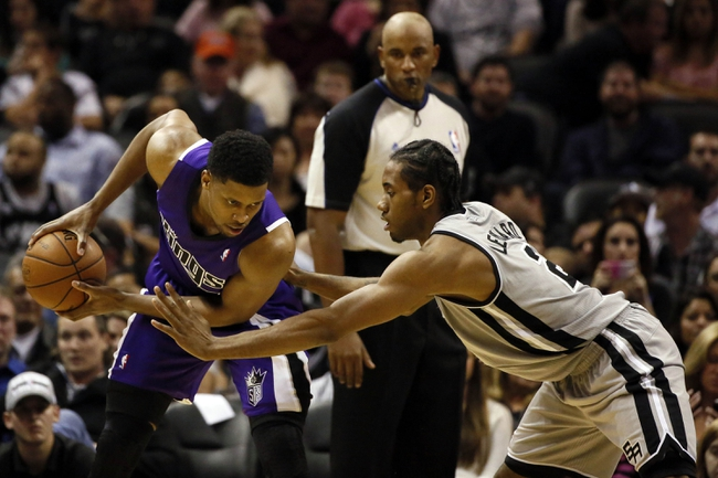 Dec 29, 2013; San Antonio, TX, USA; Sacramento Kings forward Rudy Gay (left) is defended by San Antonio Spurs forward Kawhi Leonard (2) during the first half at the AT&T Center. Mandatory Credit: Soobum Im-USA TODAY Sports