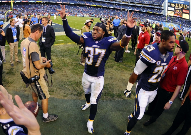 Dec 29, 2013; San Diego, CA, USA; San Diego Chargers defensive back Jahleel Addae (37) celebrates after a win against the Kansas City Chiefs at Qualcomm Stadium. The Chargers won 27-24 in overtime. Mandatory Credit: Christopher Hanewinckel-USA TODAY Sports