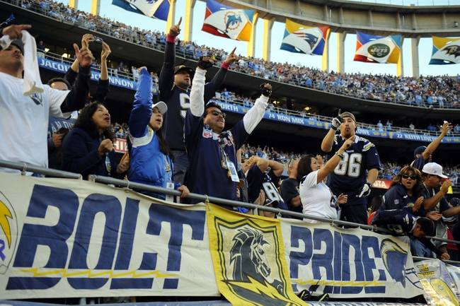 Dec 29, 2013; San Diego, CA, USA; San Diego Chargers fans celebrate following a win against the Kansas City Chiefs at Qualcomm Stadium. The Chargers won 27-24 in overtime. Mandatory Credit: Christopher Hanewinckel-USA TODAY Sports