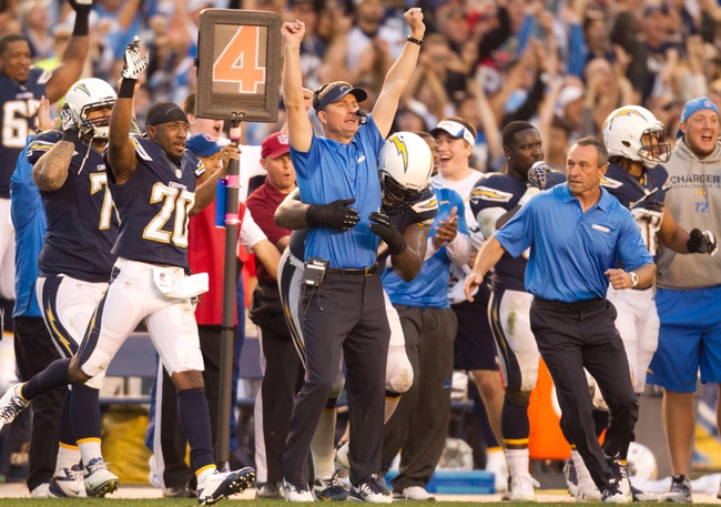 Dec 29, 2013; San Diego, CA, USA; San Diego Chargers head coach Mike McCoy celebrates the Chargers 27-24 overtime win over the Kansas City Chiefs at Qualcomm Stadium. Mandatory Credit: Stan Liu-USA TODAY Sports
