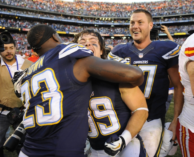 Dec 29, 2013; San Diego, CA, USA; San Diego Chargers running back Ronnie Brown (23) celebrates with running back Danny Woodhead (39) and quarterback Philip Rivers (17) after a win against the Kansas City Chiefs at Qualcomm Stadium. The Chargers won 27-24 in overtime. Mandatory Credit: Christopher Hanewinckel-USA TODAY Sports