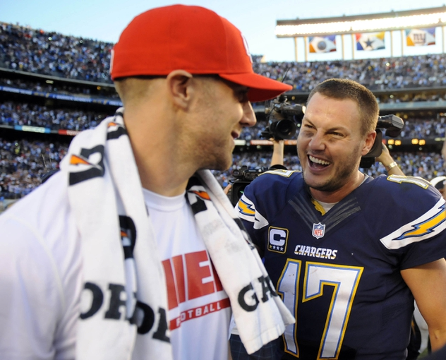 Dec 29, 2013; San Diego, CA, USA; San Diego Chargers quarterback Philip Rivers (17) talks with Kansas City Chiefs quarterback Alex Smith (11) after a Chargers win at Qualcomm Stadium. The Chargers won 27-24 in overtime. Mandatory Credit: Christopher Hanewinckel-USA TODAY Sports