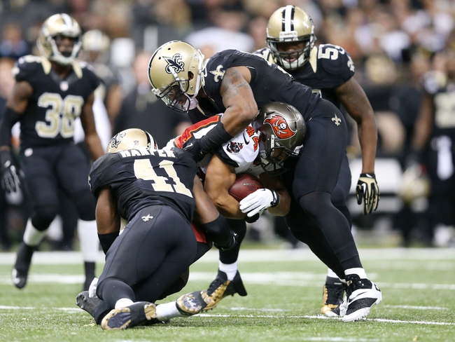 Dec 29, 2013; New Orleans, LA, USA; Tampa Bay Buccaneers running back Michael Hill (44) is tackled by New Orleans Saints outside linebacker Ramon Humber (right) and strong safety Roman Harper (41) in the second half at the Mercedes-Benz Superdome. New Orleans defeated Tampa Bay 42-17. Mandatory Credit: Crystal LoGiudice-USA TODAY Sports
