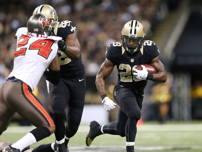 Dec 29, 2013; New Orleans, LA, USA; New Orleans Saints running back Khiry Robinson (29) carries the ball in the second half against the Tampa Bay Buccaneers at the Mercedes-Benz Superdome. New Orleans defeated Tampa Bay 42-17. Mandatory Credit: Crystal LoGiudice-USA TODAY Sports