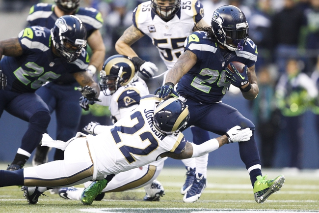 Dec 29, 2013; Seattle, WA, USA; Seattle Seahawks running back Marshawn Lynch (24) runs with the ball against the St. Louis Rams during the fourth quarter at CenturyLink Field. Mandatory Credit: Joe Nicholson-USA TODAY Sports