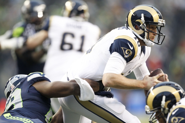 Dec 29, 2013; Seattle, WA, USA; St. Louis Rams quarterback Kellen Clemens (10) is sacked by Seattle Seahawks defensive tackle Clinton McDonald (69) during the fourth quarter at CenturyLink Field. Mandatory Credit: Joe Nicholson-USA TODAY Sports
