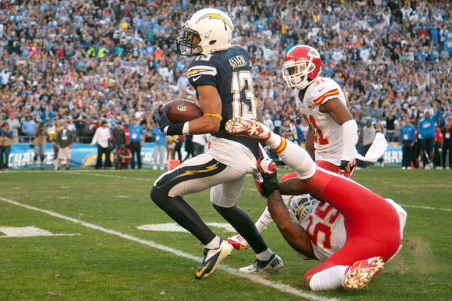 Dec 29, 2013; San Diego, CA, USA;  San Diego Chargers wide receiver Keenan Allen (13) is brought down by Kansas City Chiefs linebacker Akeem Jordan (55) in the 4th quarter during the Chargers 27-24 overtime win over the Kansas City Chiefs at Qualcomm Stadium. Mandatory Credit: Stan Liu-USA TODAY Sports